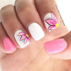Simple yet beautiful white and pink mattes polish. Additional pink flowers with blue and yellow accents are also added on top as design.