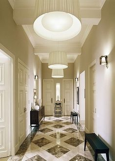 Color for foyer: taupe walls, white, brown and black marble floors.