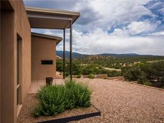 With breathtaking mountain views and a ultra modern design and decor Butterfly House is a fabulous home for rent in Santa Fe. This 2 Bedroom 2 Bathroom Santa Fe Vacation Home sleeps a maximum of 4 people and is just a short drive to the Santa Fe Opera and the Plaza. The initial design concept of this residence was to provide a vibrant entry and open living space in the heart of a minimal arrangement of supporting spaces / forms rooted in the earth. The implied butterfly roof is the inter...