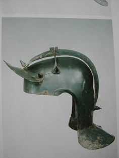 "A particulary well preserved example of a Niederbieber type helmet in bronze (photos from the catalogue ""Römer zwischen Alpen und Nordmeer"", private collection). Note the additional cross-reinforcements of the skull, cheeks are missing. The helmet took a hit in the neck. Late second century CE, the most advanced helmet type developed by the Roman army."