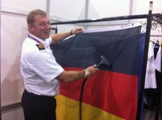 Cpo (coxn) sm Chris Thomas Preparing the flags for the judo victory ceremony.
