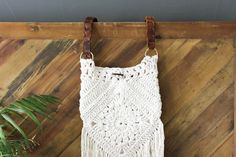 """Boho love! This free boho crochet purse pattern is fun to put together and loaded with bohemian charm. Made with Lion Brand Kitchen Cotton in """"Vanilla."""""""