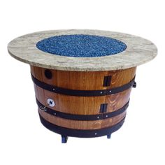 Hand-crafted from retired and repurposed white oak wine barrels straight from Napa Valley, this propane fire pit would look great on any patio. A propane tank fits comfortably inside the barrel, and the wheels on the bottom make it easy to get it where you want it.