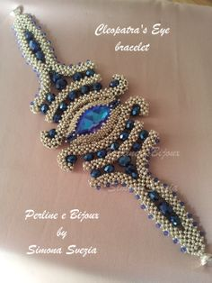 Cleopatra's Eye by Simona Svezia. Beautiful. The pattern is supposed to be for sale in her Etsy store but I couldn't find it! Check out her other patterns that are for sale.   https://www.etsy.com/shop/PerlineeBijoux?ref=listing-shop-header-item-count
