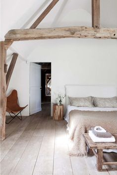 Beautiful beams in this country bedroom. Love the natural fabrics on the bedding and the clean white lines, giving a fresh, contemporary look. If you like this pin, why not head on over to get similar inspiration and join our FREE home design resource library at http://www.TheHomeDesignSchool.com/signup?
