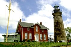 The Old Fairport Harbor Lighthouse, east of Cleveland, is believed to be haunted by a gray cat, one of many owned by a former lighthouse caretaker. The myth was given more credence when, in 2001, the remains of a cat were discovered in a sealed staircase. The remains are now on display in the museum, but the playful cat's presence can be felt all over the property.