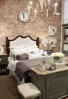 HAMPTONS LIVING: Exposed brick wall in a bedroom. This industrial look would suit the teenage boy, along with his wish of exposed rafters...!