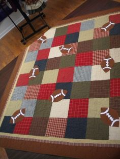 sports quilt using flannels. Pattern from a book called Fantastic Sports Quilts