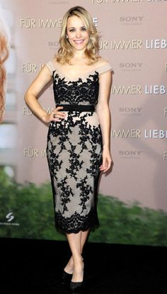 McAdams, who is known for mixing retro and glamour with grace, rocked the red carpet in a tea-length off-the-shoulder gown. McAdams paired the black lace dress from Collette Dinnigan with black heels from Christian Louboutin (who else?) and a cinched belt.