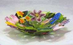 I create custom bowls featuring leaves and flowers of your choice. This bowl is approximately 14 across and stands approximately 3 1/3 tall. Each bowl is one of a kind, made from precisely cut opaque and transparent glass, crushed glass frit, and fine glass stringers all made by me