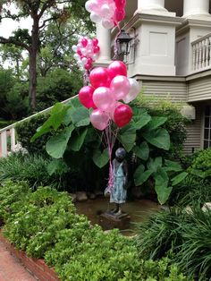 Girl statue with balloons