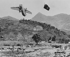 Vietnam War: An ammunition-laden American C-7 Caribou transport plane crashes after its tail section was accidentally shot off by American artillery near Đức Phổ Base Camp Vietnam August 3 1967. All three crewman died.