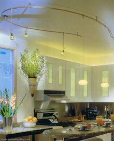 Like this lighting ALOT http://www.interiorlightingoptions.com/wp-content/uploads/2012/04/kitchen-track-lighting-2.jpg