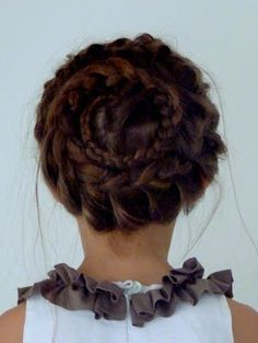 An ornate cinnamon role hair braid style.