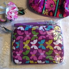 """FLASH SALE! Vera Bradley Tablet Sleeve NWT New, in original packaging! Softly padded tablet sleeve features L-shaped zip opening and handy wristlets strap. From smoke free home. Retired pattern. First 2 photos actual item.  Features: - L-shaped zip-top opening - Neoprene, padded with lightweight protective foam - Accommodates most smaller tablets, including the iPad mini and other e-readers - Dimensions: approx 8 ¼"""" W x 6 ¼"""" H x ¾"""" D - Handy detachable wristlets strap - Care Tips: Machine…"""