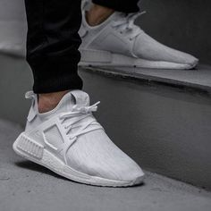"""The adidas NMD XR1 """"Triple White"""" in Primeknit releases this Thursday. For full release details on all nineteen colorways, hit the link in our bio."""