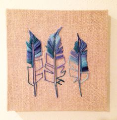 A personal favorite from my Etsy shop https://www.etsy.com/listing/270418714/embroidered-feathers-on-burlap-with-hand
