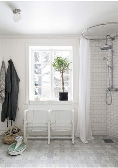 Vintage scale in a white bathroom with soft touches of green.