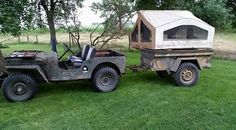 Cool Compact setup, the tent appears to be two standard tent trailer end halves sewn togther
