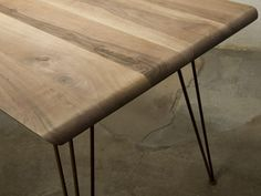 Table in Walnut and Iron Table with flat Surface made of solid Walnut wood where sides are smoothed and the Base is realized with little Iron-rounds varnished in Dust. #artigianato #tavolo #table #madeinitaly