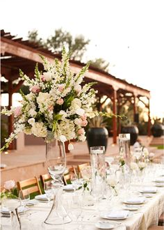 Translucent accents and tall bouquets bursting with pastel stalks create a statement tablescape at @Four Seasons Resort Scottsdale at Troon North.