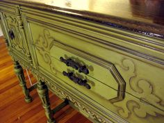 Ooo Ooo OOO! I've been so excited to share this one for a long time! This buffet's awesomeness is twofold. a) we refinished it ourselves. b) it was free That's right.  FREE. I'll tell you the story in a moment, but I just can't resist the affects of a before and after shot. So here …
