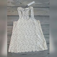 Romantic Lace Tank Top (NEW) Beautiful racer back tank top in cream lace. Brand new with tags. Solitaire  Tops Tank Tops