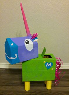 Unicorn Valentine's Day mailbox for my kiddo. Body and head made from Post Office boxes, cut to shape and taped together with brown paper tape. Horn and legs are paper towel rolls. Mod Podge over brown tape, then paint. Assemble pieces with hot glue gun.