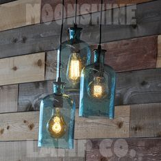 A cool beach glass, blue bottle recycled bottle lamp fixture made in Claremont, California by Moonshine Lamp