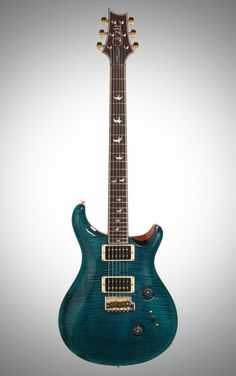 PRS Paul Reed Smith Custom 24 10 Flame Top 30th Anniversary Electric Guitar, Regular Neck: Pick up a true collectible in this 30th-anniversary Custom 24. A quilted, carved figured maple top and commemorative bird inlays make for a timeless guitar.