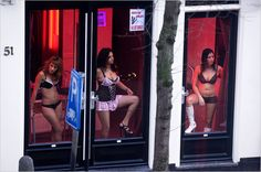 Red Light Girls. Amsterdam, Holland.    Yes as you walk down this part of the city, this is what you see. The girls in the windows.