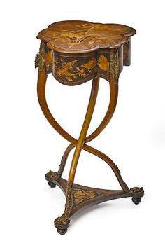 An unusual French gilt bronze mounted marquetry inlaid table attributed to Charles-Guillaume Diehl late 19th century