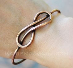 Infinity Knot Bangle Oxidized Copper Wire by Karismabykarajewelry