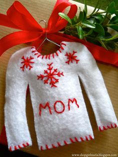 Christmas sweater gift tags! Adorable! Might have to one of these for our felt ornament crafts.