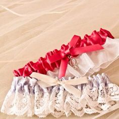 Wedding garters 9-24-11    Blue one was my moms, sewed a ring on the pink one for the throw