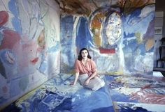 Portrait of American abstract painter Helen Frankenthaler in her studio, surrounded by her paintings, New York, New York, circa 1957.