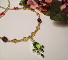 Multi-colored Crystal Necklace with Peridot Colored Glass Pendant,$44.95, #RomanticThoughts.etsy.com, #jewelry, #summer_colors