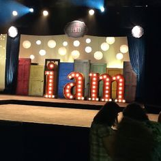 I like the doors on this church stage set. Also we could prob make huge letters out of cardboard and cut holes for light bulbs the electrical part in unsure about though Stage Set Design, Church Stage Design, Kids Church Decor, Church Ideas, Decor Eventos, Kids Stage, Church Interior Design, Church Ministry, Church Events
