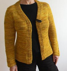 Tric, an A-line shaped cardigan with strong and simple lines, is knitted in one…