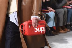 Closer look at a bag from the Louis Vuitton Fall-Winter 2017 Fashion Show by Men's Artistic Director Kim Jones, designed in collaboration with Supreme. The Show was presented in the Palais Royal in Paris, France.