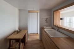 An oak-edged window creates a framed view in this Tokyo apartment, intended by Yumiko Miki Architects to create the effect of a still-life painting Japan Apartment, Apartment Interior, Minimalist Kitchen, Minimalist Interior, Beautiful Architecture, Architecture Design, Narrow House Designs, Japanese Bathroom, Best Kitchen Designs