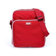 "ASAOKA RETRO STYLE FLIGHT BAG Retro style flight bag with ASAOKA vinyl label applique. The vinyl label says ""朝岡・ストランド衣料品 "" -""Asaoka・Strand Clothing"" レトロスタイルの「朝岡」ショルダーバッグ。 - dimensions: 33cm x 29cm x 14cm - adjustable shoulder/cross body strap - zippered main compartment - zippered front pocket - internal mesh pockets - outer fabric 600D Polyester"
