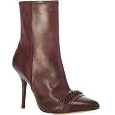 The burnished leather adds a well-worn nonchalance to this sophisticated pair of high-heeled booties. These chic side-zip booties have textural extras like the…