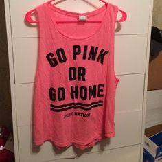 Victoria's Secret Pink tank top Go pink or go home pink nation tank top in Medium. Worn a couple times, flaw shown in picture but not noticeable. Tank top was too big for me, worn once as a swim suit coverup. No trades please! PINK Victoria's Secret Tops Muscle Tees