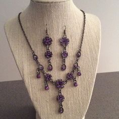 "NWOT Amethyst and Silver Earring and Necklace Set Stunning amethyst and silver flower set.  Necklace measures approximately 18"" long + 3"" extender.  Matching amethyst earrings measure approximately 2.5"" drop.  For pierced ears.  Distressed look. Jewelry Necklaces"