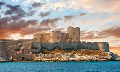 Atmospheric sunset over the famous Chateau d'If castle in Marseille