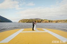 Bride and Groom on West Point Helicopter Pad on the Hudson River!  Photo by Athena Blude Photography