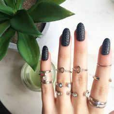 These are matte black with glossy dots oval nails Each set contains; - 10 false…