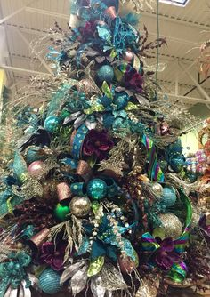 #Teal blue and brown chocolate #Christmas tree. Designed by Arcadia Floral and Home Décor