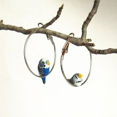 Cute parrot portait on hoop earrings. Bird jewelry made from plymer clay.